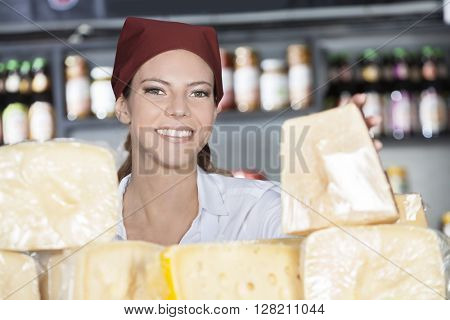 Happy Woman Selling Fresh Cheese In Store