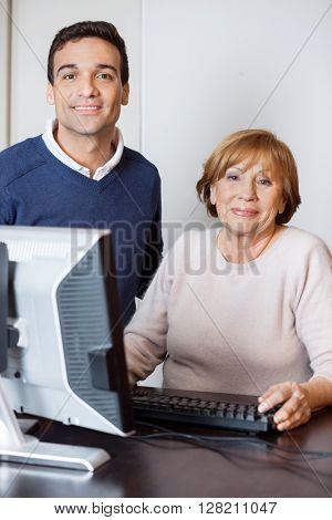 Happy Tutor And Senior Woman In Computer Lab
