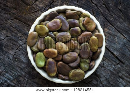 Dried Broad Beans On Old Wooden Table