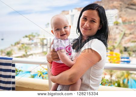 Happy baby girl with her mother on holidays in Spain