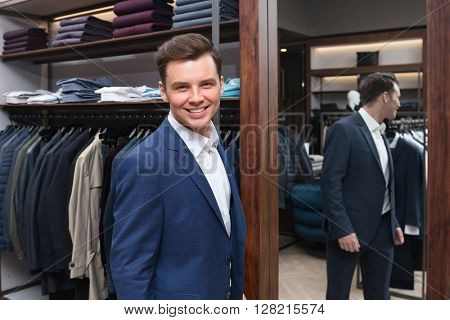Smiling man in a store