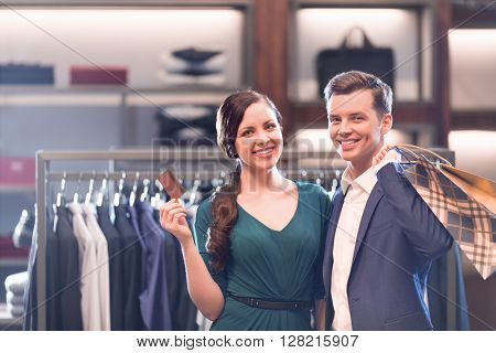 Young couple with credit card in shop
