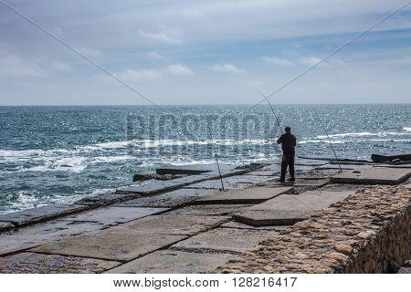 fisherman black sea odessa pier