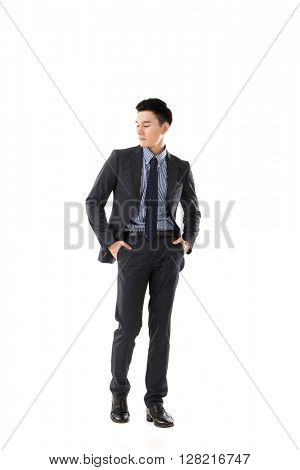 Attractive young Asian businessman, full length portrait isolated