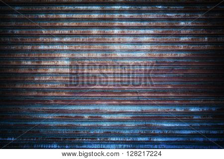 Rusted metal grille background with traces of old blue paint.