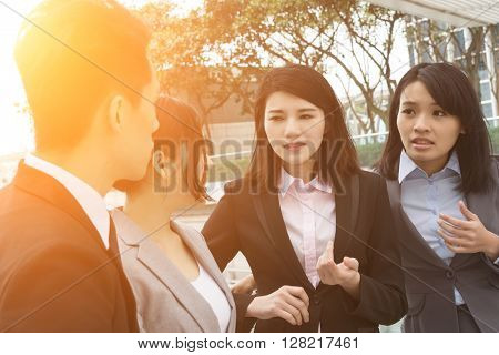 group of Asian business man and woman talk to each other