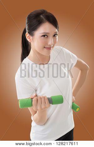 Asian woman in sport holding dumbbell.