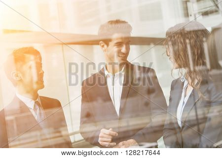 Group of business people discuss something inside office