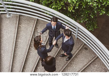 Top view of business people hand shaking to each other