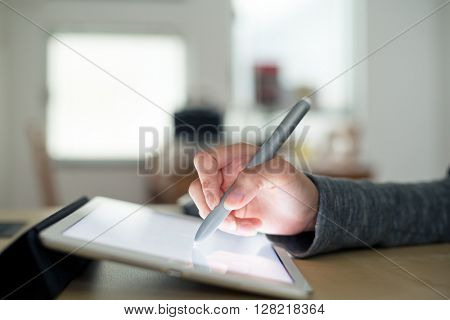 Woman using pen drafting on tablet