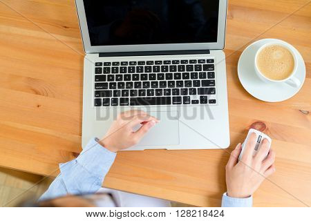 Female hands with laptop computer