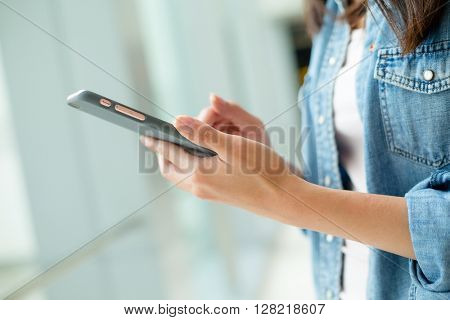 Woman reading something on cellphone