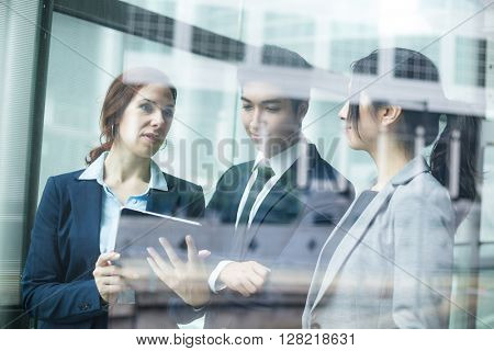 Business people working on tablet pc