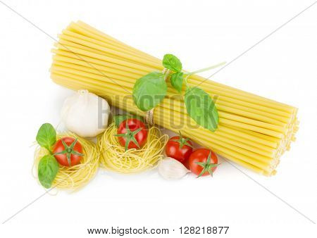 Italian pasta, tomatoes, basil and garlic. View from above. Isolated on white background