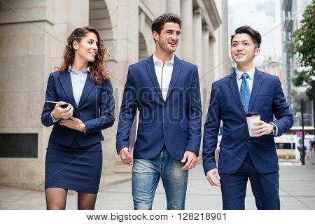 Business team walking outside office