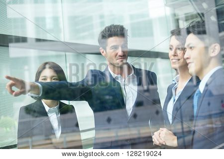 Business people discuss the project planning inside office