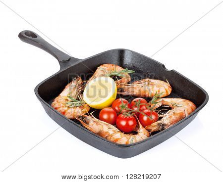 Grilled shrimps on frying pan. Isolated on white background