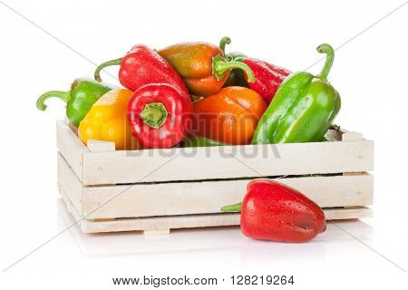 Fresh colorful bell peppers box. Isolated on white background