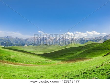 Beautiful landscape with green hills and magnificent cloudy sky. Exploring Armenia