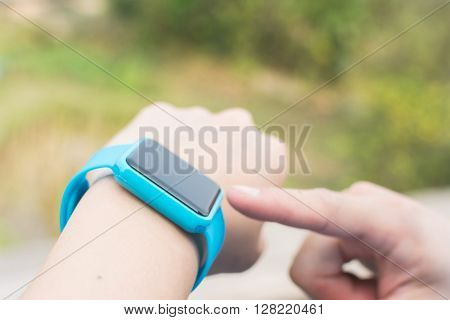 Man use of wearable watch at outdoor