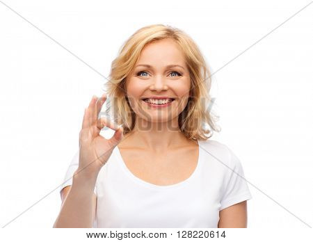 gesture, advertisement and people concept - smiling woman in blank white t-shirt showing ok hand sign