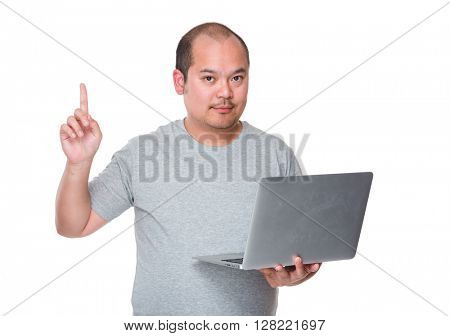 Asian man hold with laptop and finger point up