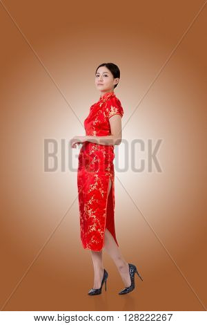 Chinese woman in traditional cheongsam in the new year