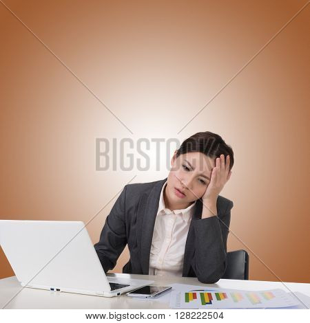 Worried business woman of Asian using laptop on desk, closeup portrait.