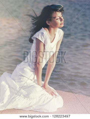 Beautiful young woman in blissful serene relaxed pose