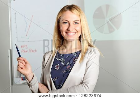 Smiling business woman presenting. Presentation on a background