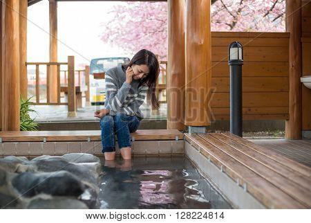 Woman relaxing her foot hotsprings