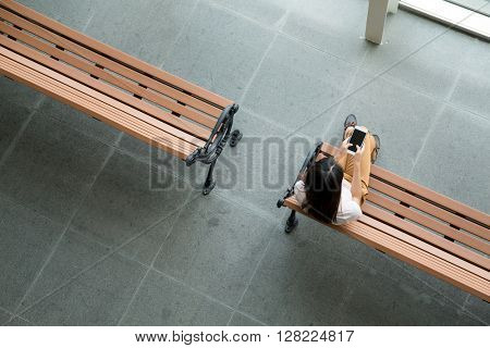 Top view of woman using smart phone