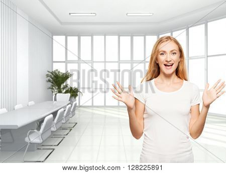 Happy businesswoman in the office. Young smiling female inside