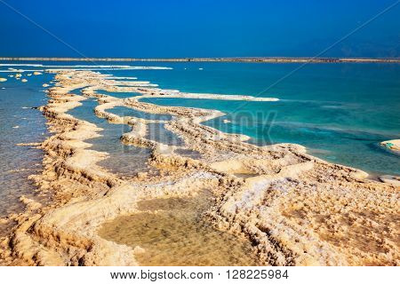 Path from the evaporated salt on a water surface. The Dead Sea at coast of Israel