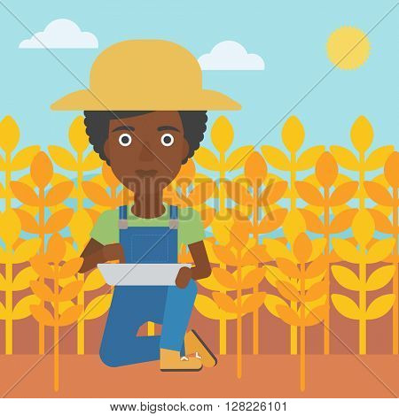 Farmer with tablet computer on field.