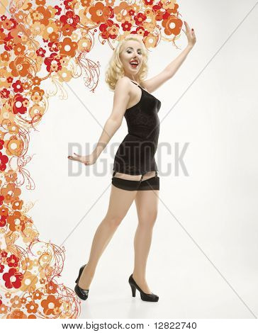 Attractive Caucasian woman wearing retro lingerie in pinup pose with graphic background.