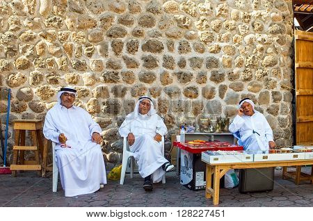 Dubai U.A.E. - November 10 2006: Local old merchants sitting in the old souk
