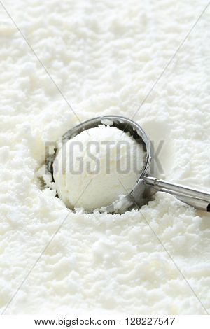White Ice Cream Scooped Out From Container