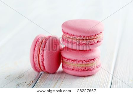 Tasty Pink Macarons On A Blue Wooden Table