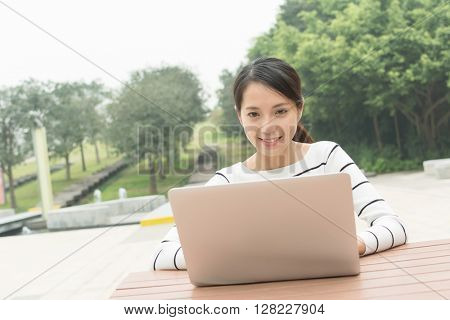 Woman use of laptop computer at outdoor cafe
