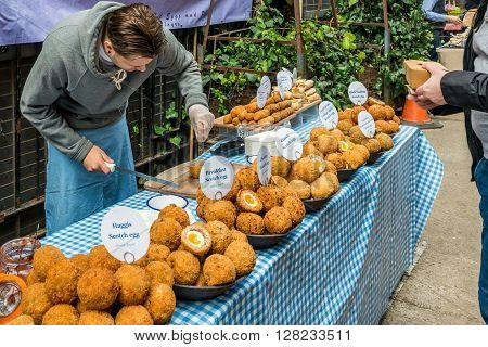 London United Kingdom - April 30 2016: Maltby Street Market in Bermondsey (located in railway arches SE1 Rope Walk). Great artisan street food stalls and bars. Scotch eggs stall