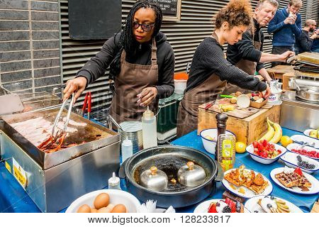 London United Kingdom - April 30 2016: Maltby Street Market in Bermondsey (located in railway arches SE1 Rope Walk). Great artisan street food stalls and bars. Waffles stall