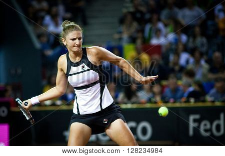 CLUJ-NAPOCA, ROMANIA - APRIL 16, 2016: Women tennis player Irina Begu (Romania) plays against Angelique Kerber (Germany) during Tennis Fed Cup play-offs