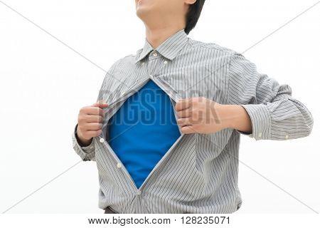 businessman showing superhero suit underneath his shirt