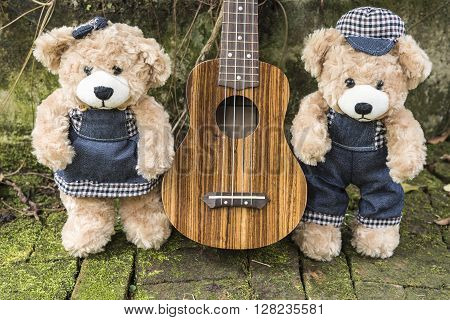 couple teddy bears with ukulele in garden love and friendship concept