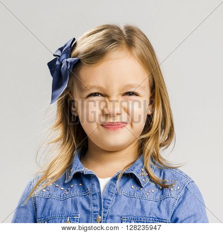 Portrait of a little girl with a smiling expression