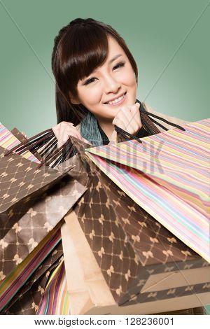 Asian woman shopping, closeup portrait with bags