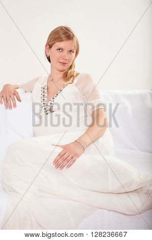 Pregnant woman relaxing at home on the couch