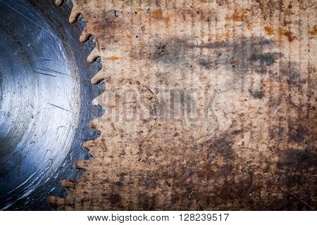 Color image of a cutting disk on a wooden plank.