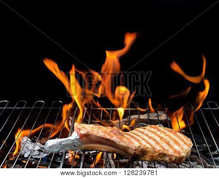 grill concept with flame.  steak on the grill with flames. barbecue